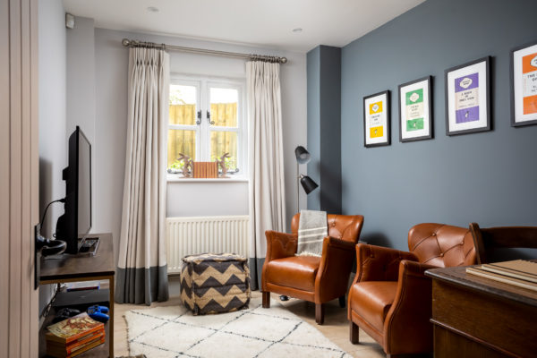 leather armchairs in a cosy TV room with Berber rug