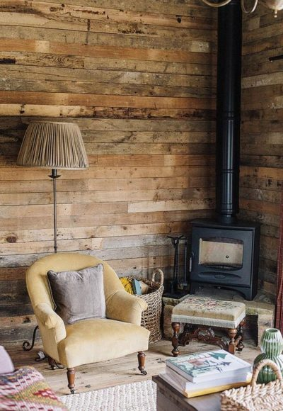 Cosy fireplace at Soho Farmhouse. Living area for garden room wood burner stove