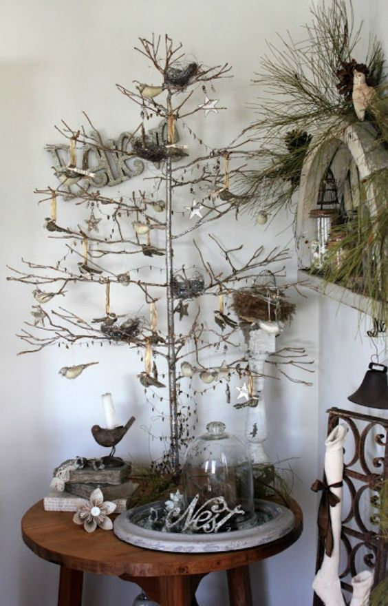 branch decorated with christmas decorations on a small miking stool