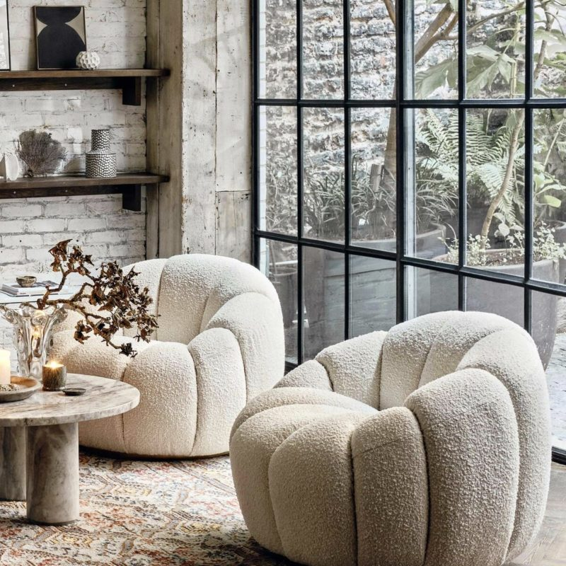 critall windows with curved boucle chairs