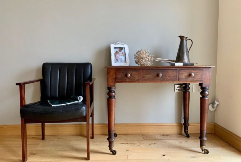 Vintage furniture with writing table and leather chair