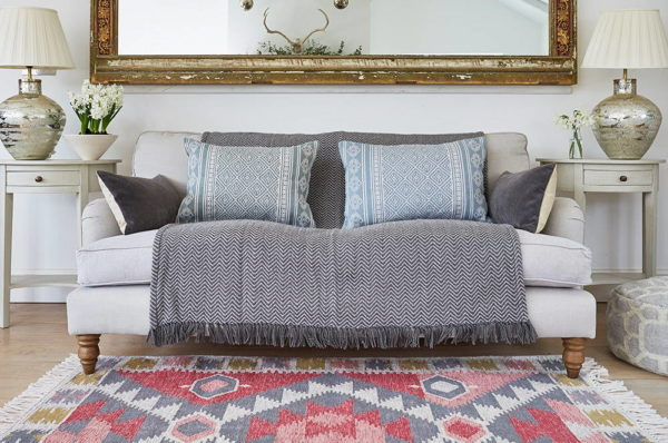 Weaver green recycled rug with sofa and throw with cushions