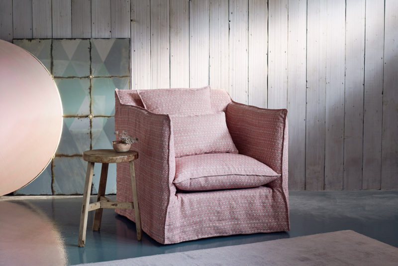 loose cover on a arm chair in a pink fermoie fabric
