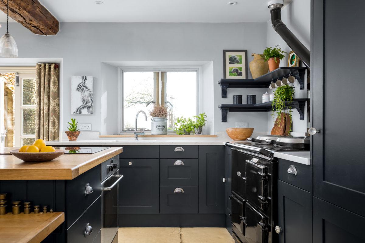 kitchen units in Farrow & Ball railings. Kitchen shelves and Aga range cooker