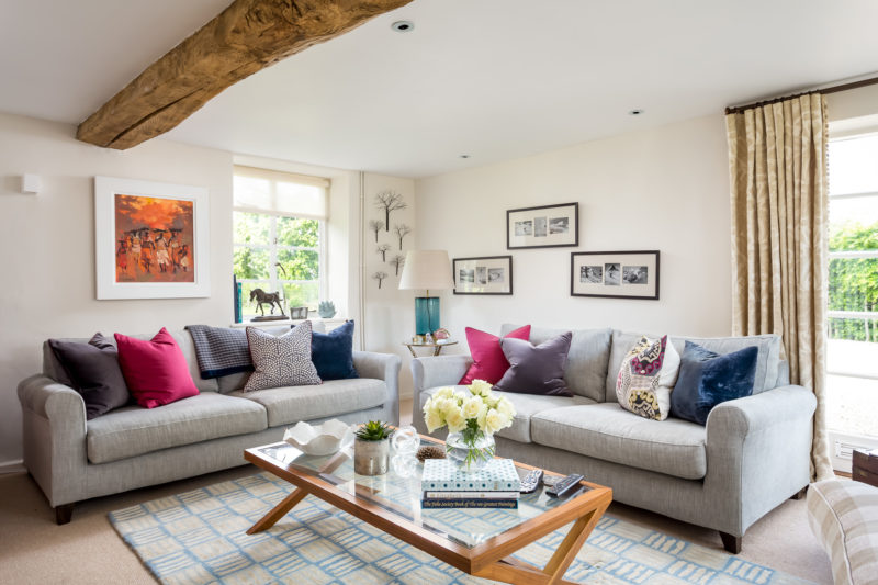 cushions on a corner sofa with rug and coffee table