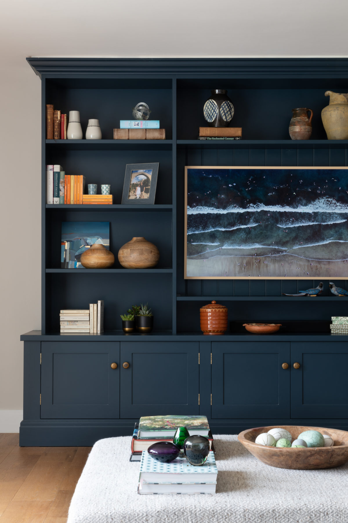Hague blue bookcase with TV and styled shelves