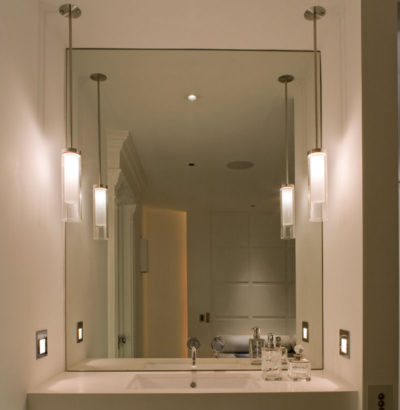 Bathroom pendant lights to sides of a mirror